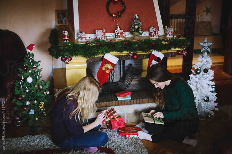 Two female friends opening Christmas gifts by Jovana Rikalo for Stocksy United