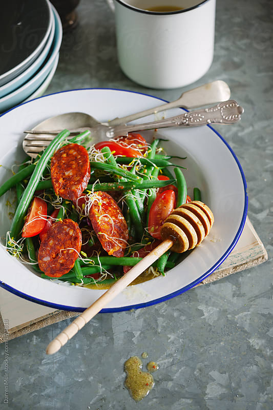 Freshly made green bean and chorizo sausage salad. by Darren Muir for Stocksy United