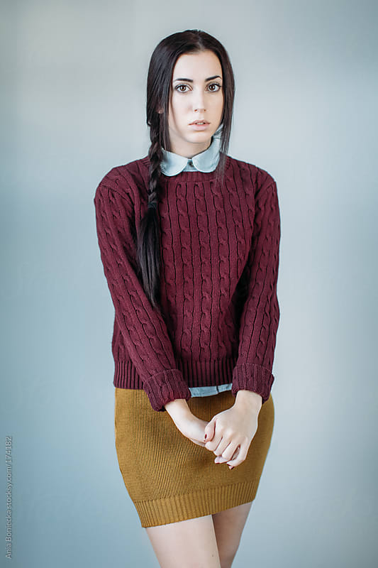 Studio portrait of a beatiful girl with long hair by Ania Boniecka for Stocksy United