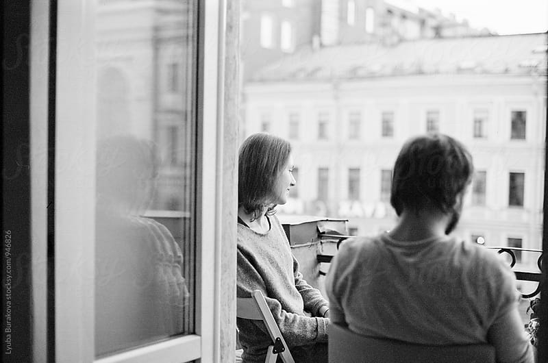 Friends on a balcony by Lyuba Burakova for Stocksy United
