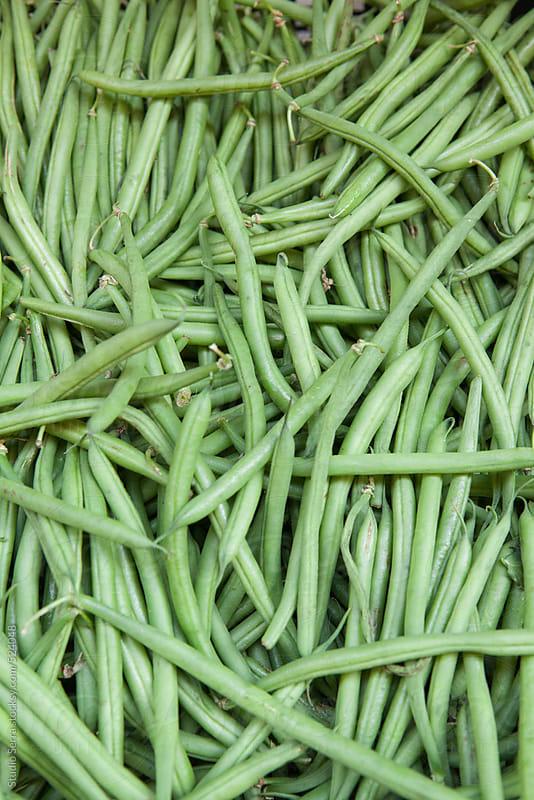 Organic green bush beans for sale at farmer's market by Alberto Bogo for Stocksy United