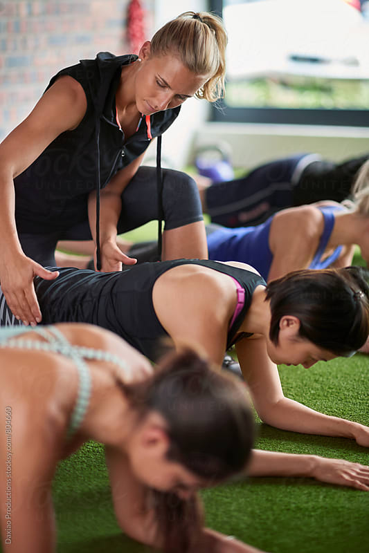 Muscular lean Caucasian women doing push ups exercises planking at urban gym by Daxiao Productions for Stocksy United