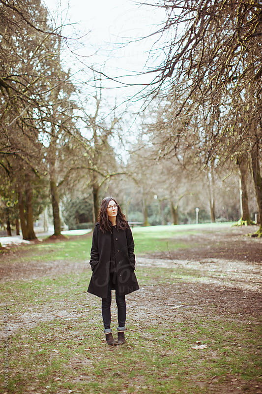 Woman Stands In Park by Kevin Gilgan for Stocksy United