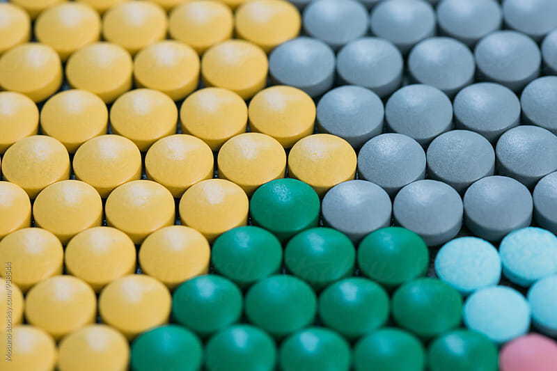 Stack of Pills  by Mosuno for Stocksy United