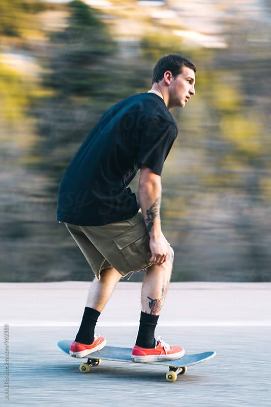 Skateboarder Panning Shot by Jake Elko for Stocksy United