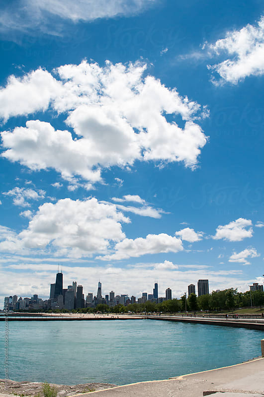 lake michigan and chicago's skyline by Margaret Vincent for Stocksy United