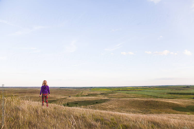 Alone in the vast prairie. by Cherish Bryck for Stocksy United