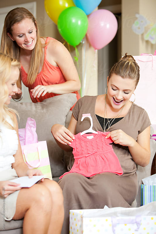 Baby Shower: Excited To Get Pink Dress for Baby by Sean Locke for Stocksy United