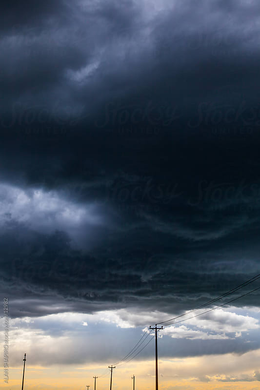 Stormclouds over telephone lines by ALAN SHAPIRO for Stocksy United