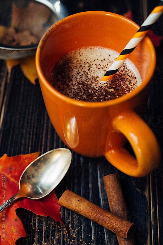 Cappucino Coffee in orange cup by Gabriel (Gabi) Bucataru for Stocksy United