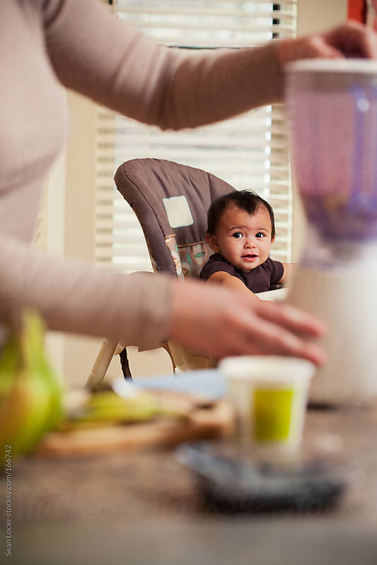 Baby: Mother Making Homemade Baby Food from Bananas and Blueberr by Sean Locke for Stocksy United