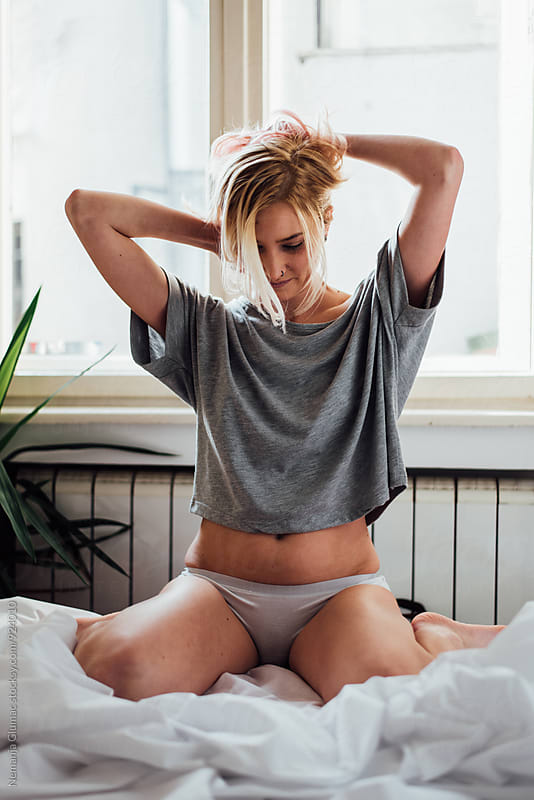 Young Blond Woman Posing in Bed by Nemanja Glumac for Stocksy United
