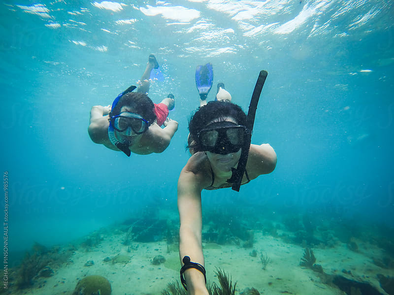 Couple Snorkeling Together in Tropical Blue Water by MEGHAN PINSONNEAULT for Stocksy United