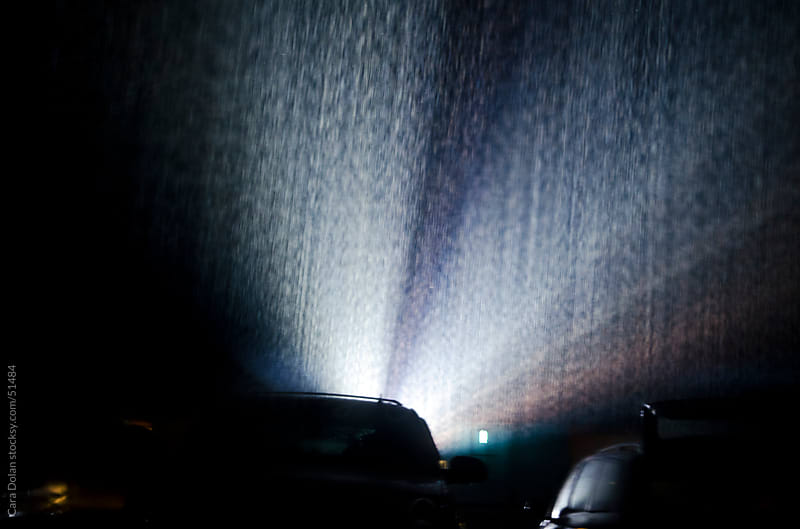 Pouring rain at the drive-in movie theater by Cara Slifka for Stocksy United