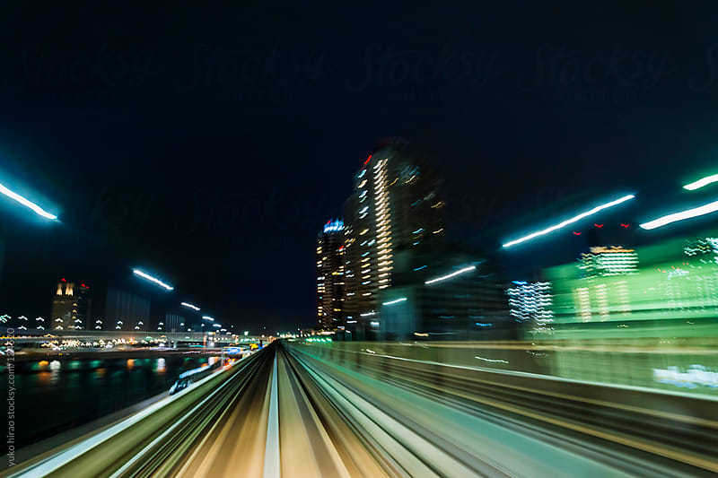 Speed and motion - driving into big city at night by yuko hirao for Stocksy United