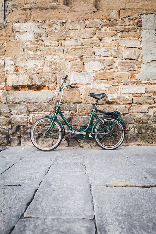 Small Bicycle Leaning on an Italian Stone Wall by Giorgio Magini for Stocksy United