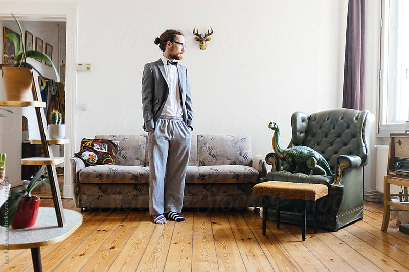 Young man in half suit half sweat pants by Ivar Teunissen for Stocksy United