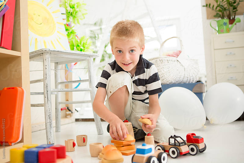 Boy Playing With Toy Cars by Lumina for Stocksy United