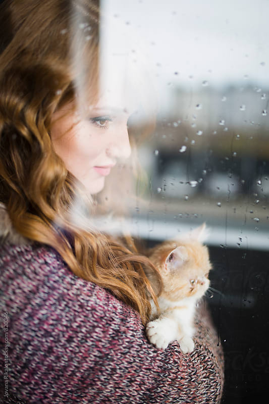 Young woman and her kitten by Jovana Rikalo for Stocksy United