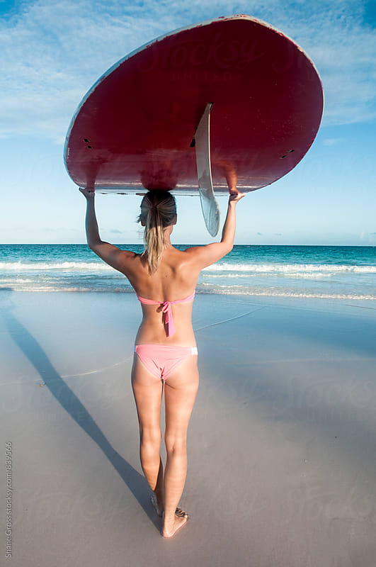 Girl with Stand Up Paddle Board on the Beach by Shane Gross for Stocksy United