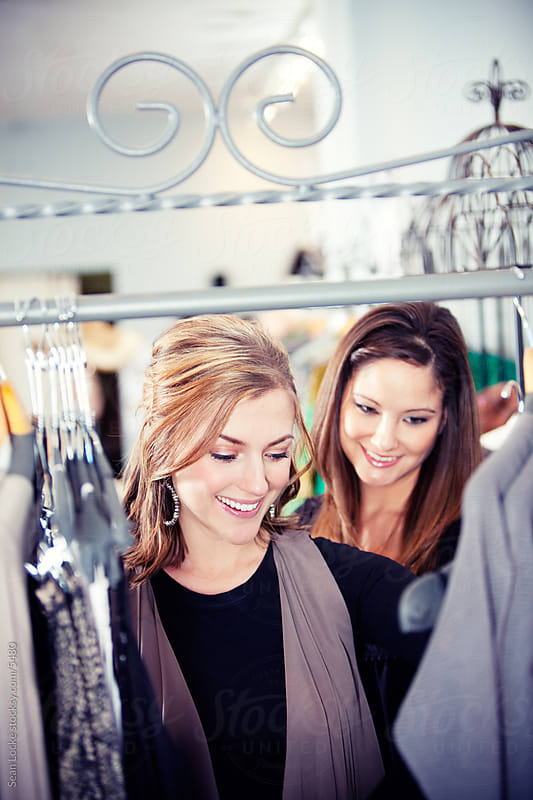 Boutique: Two Friends Browse the Clothing Racks by Sean Locke for Stocksy United