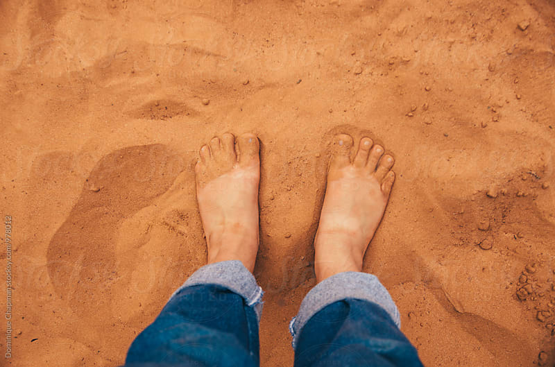 Feet in red outback dirt by Dominique Chapman for Stocksy United