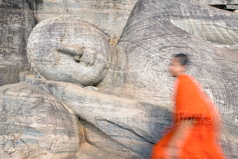 Monk at a rock-cut image of the Buddha in the Gal Vihara, Polonnaruwa (Polonnaruva), UNESCO World Heritage Site, Sri Lanka, Asia by Gavin Hellier for Stocksy United