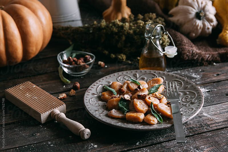 Homemade pumpkin gnocchi with sage and roasted hazelnuts by Nataša Mandić for Stocksy United