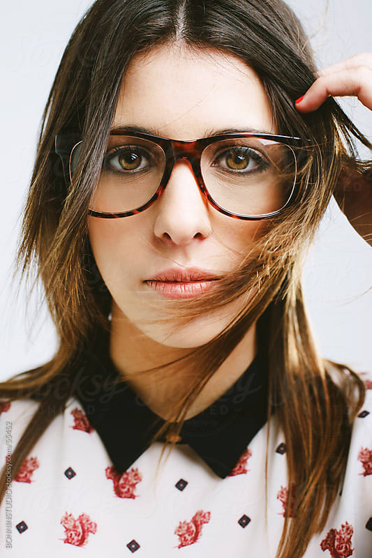 Young beautiful woman with glasses. Retro style. by BONNINSTUDIO for Stocksy United