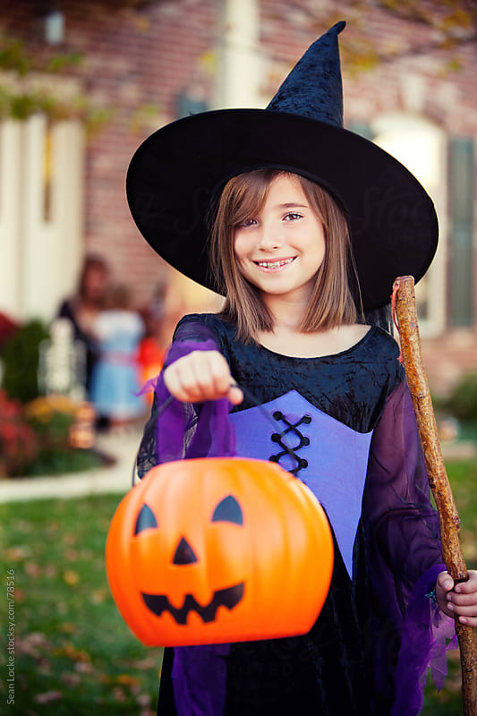 Halloween: Witch Ready for More Candy on Halloween by Sean Locke for Stocksy United