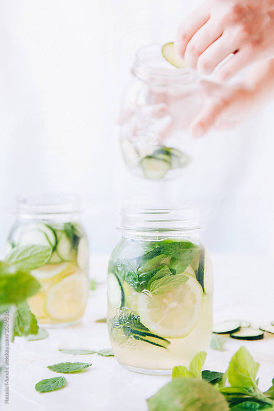 Cucumber water with mint and lemon by Nataša Mandić for Stocksy United