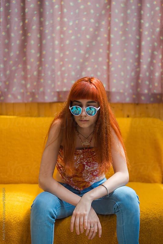 Portrait of ginger girl with sunglasses by Katarina Simovic for Stocksy United
