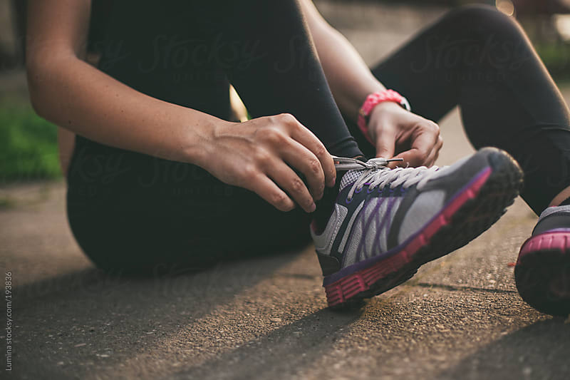 Sportswoman Tying Shoelaces by Lumina for Stocksy United