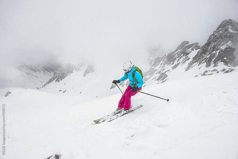 Female skier off-piste skiing by RG&B Images for Stocksy United