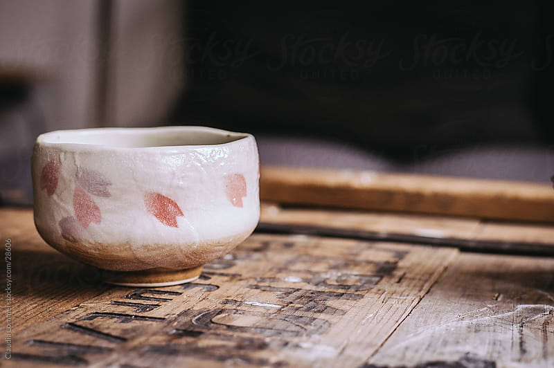 Tea Mug on a Wooden Board by Claudia Lommel for Stocksy United
