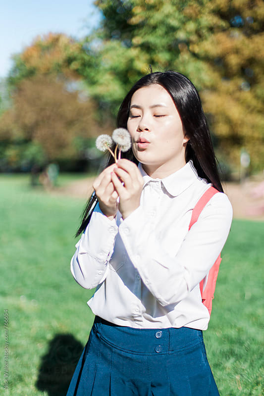 Young Asian Girl In The Park by Nick Walter for Stocksy United
