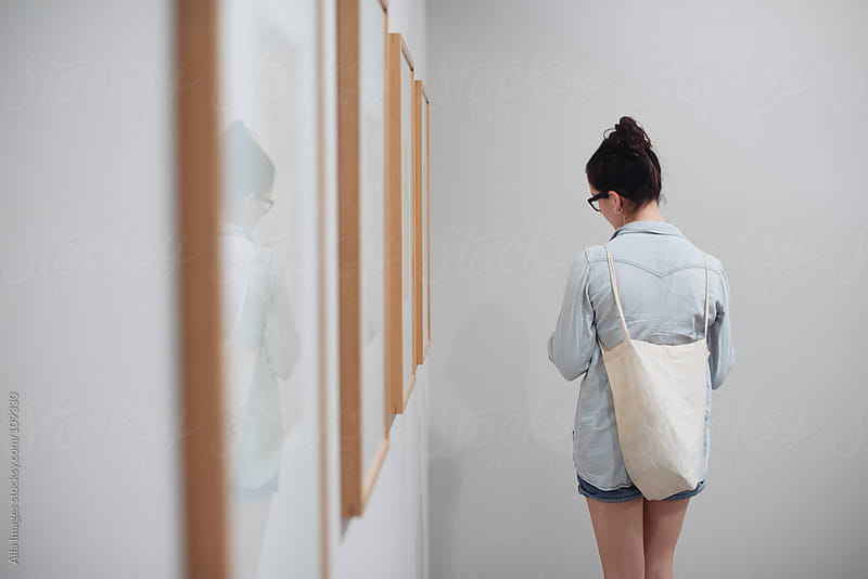 Girl browsing in Art Gallery by Aila Images for Stocksy United