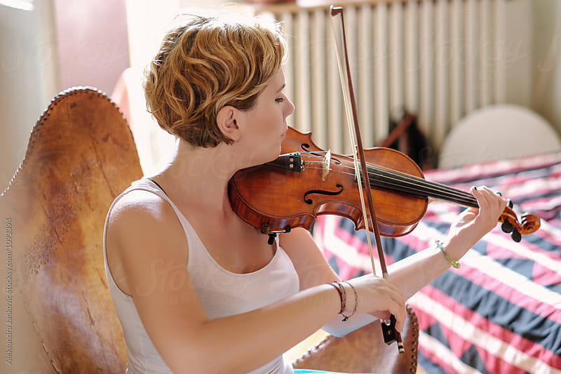 Young Woman Practicing Violin by Aleksandra Jankovic for Stocksy United