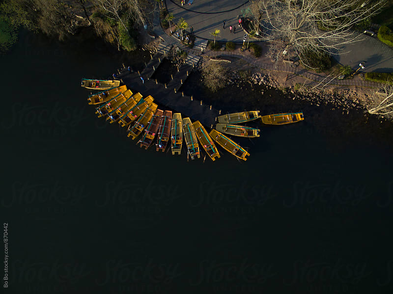 looking down of the boats on the lake by Bo Bo for Stocksy United
