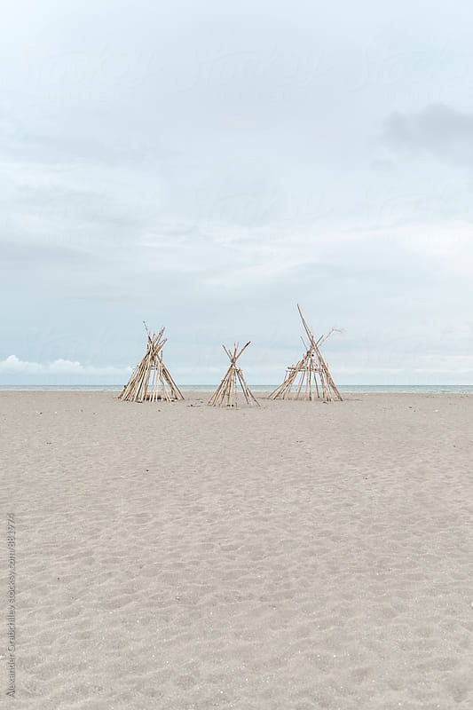Bamboo Wigwams On A Sandy Beach by Alexander Grabchilev for Stocksy United