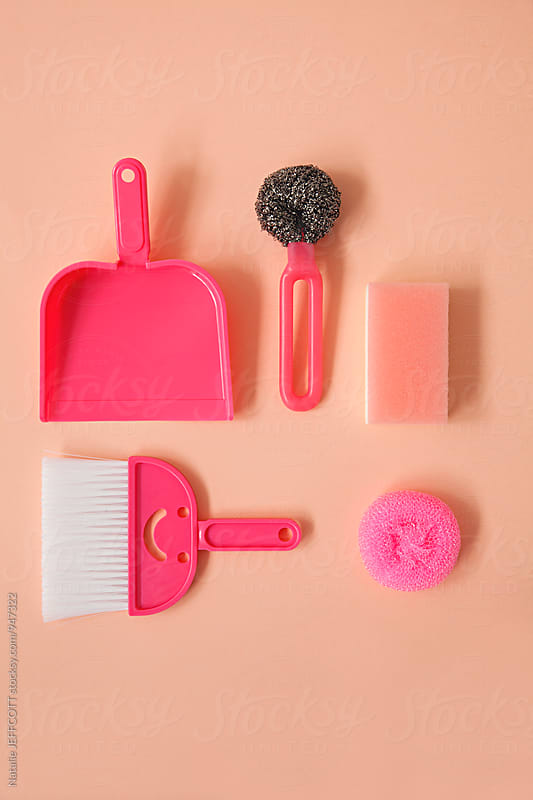 Flatlay collection of pink household cleaning items arranged on pink bacground by Natalie JEFFCOTT for Stocksy United