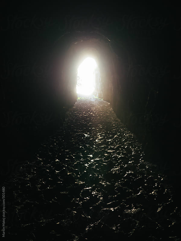 Light at the end of muddy tunnel by Martin Matej for Stocksy United