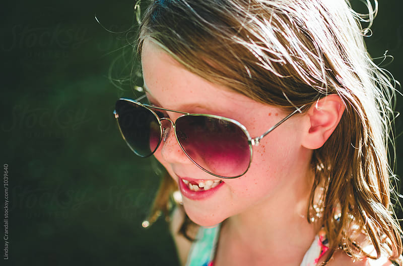 Happy girl in sunglasses by Lindsay Crandall for Stocksy United
