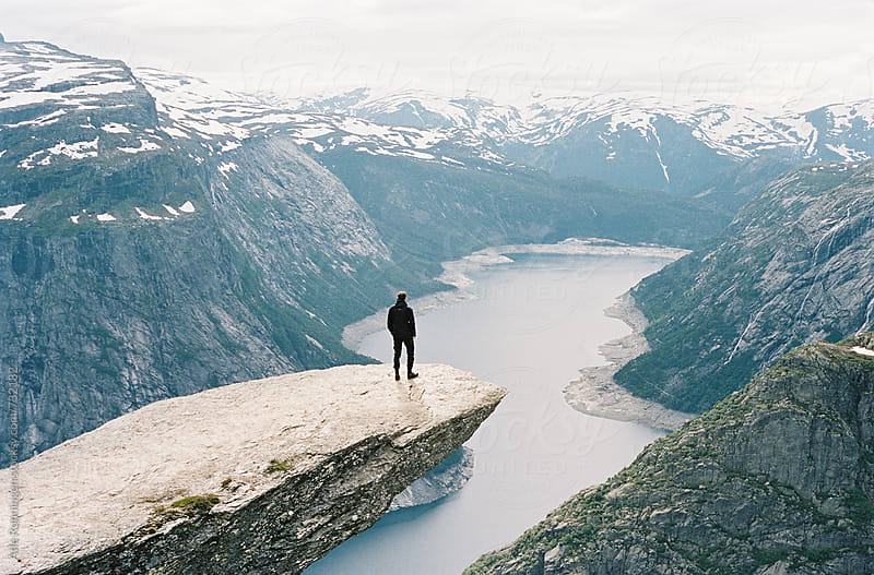 A young hiker reached the edge of Trolltunga in Norway by Atle Rønningen for Stocksy United