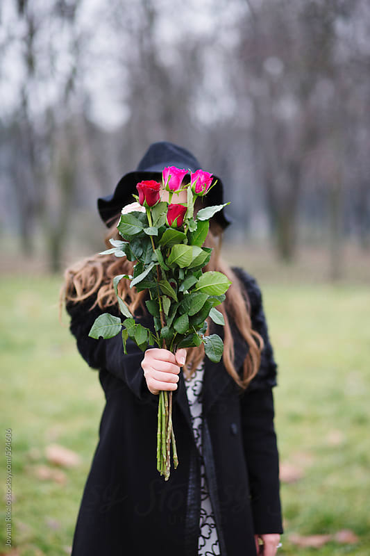 Young woman holding a bouquet of flowers by Jovana Rikalo for Stocksy United