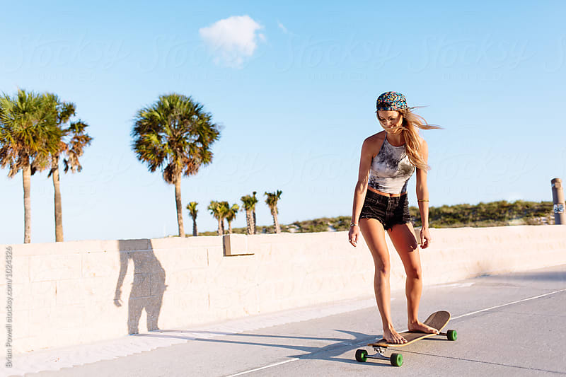 young woman on skateboard by Brian Powell for Stocksy United