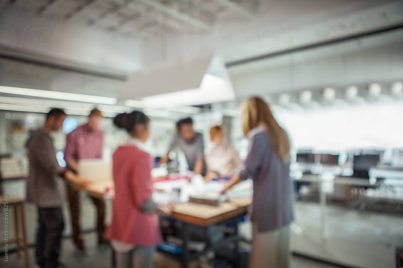 Blurred Shot of a Business Team Working Together by Lumina for Stocksy United