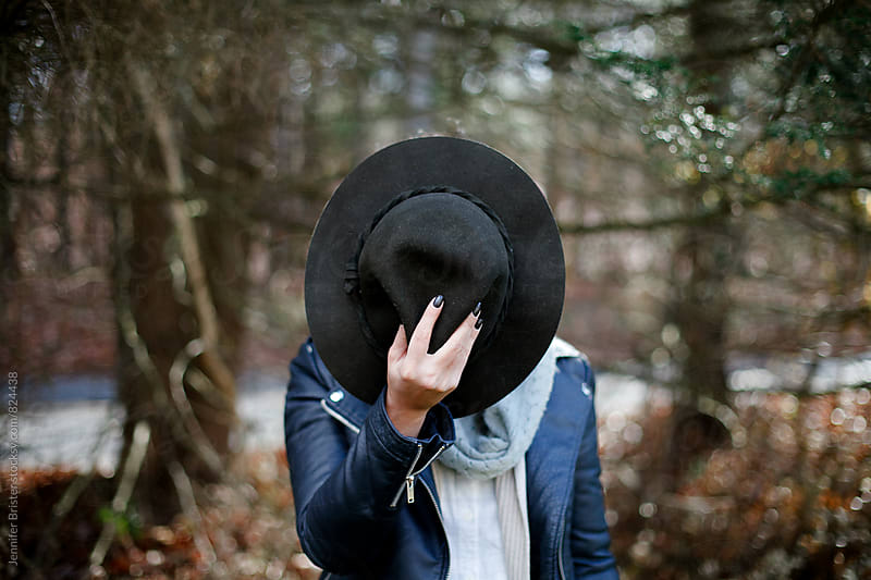 Beautiful woman wearing leather jacket and hat  by Jennifer Brister for Stocksy United