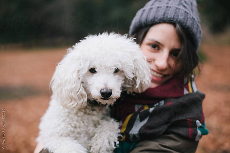 Portrait of a beautiful happy woman and her white dog outdoors  by VeaVea for Stocksy United