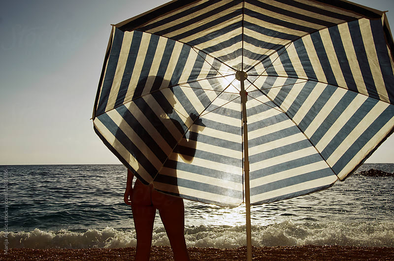 Handsome silhouette in the front of the umbrella by Marija Anicic for Stocksy United